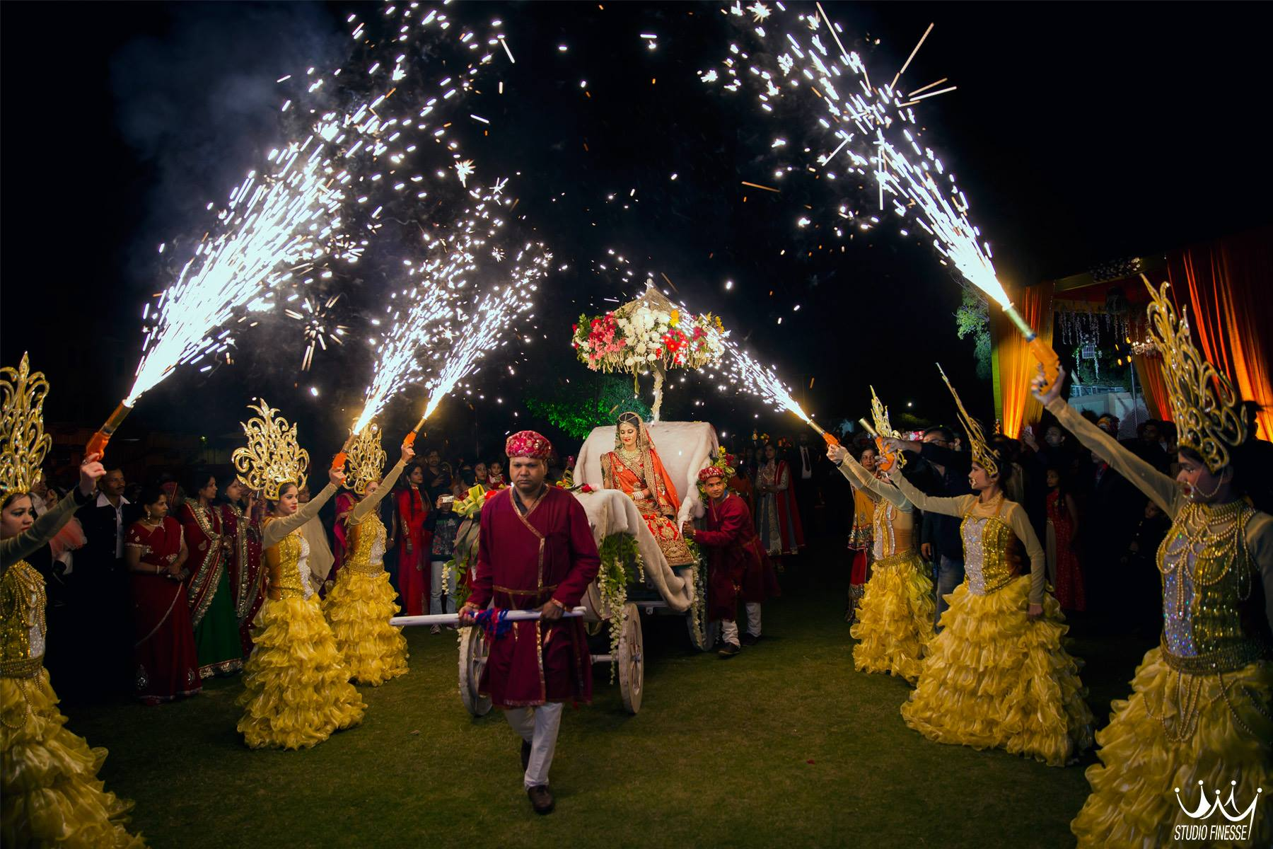 bridal entry, bride entry with sparklers, red lehenga, bridal lehenga
