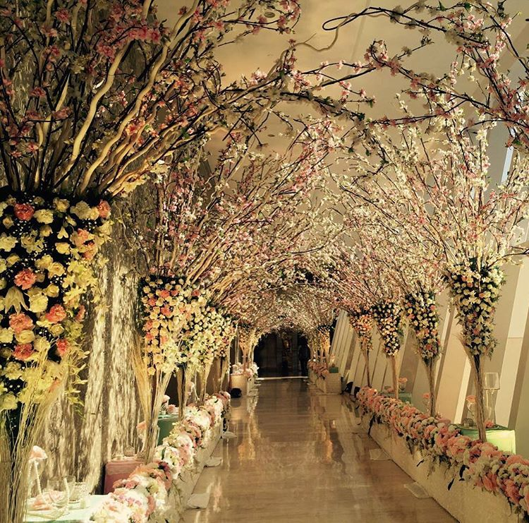 13 wedding entrance decor ideas that you need to save and show to there are so many ways to use florals in the decor and our favorite way is by creating one large bouquet around the arc of the entrance junglespirit Images