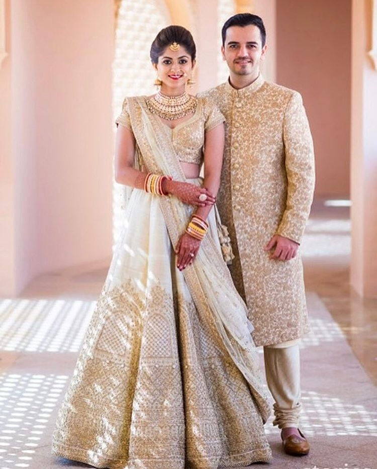 eeb4ada989 Dhrumil looked remarkable in the gold and ivory embroidered sherwani  matching Anusha's Lehenga at their Beach wedding in Muscat. Ideal for the  summer bride ...