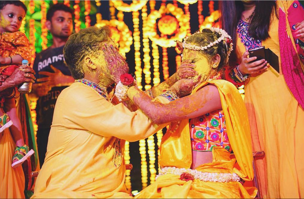 bride and groom haldi photos