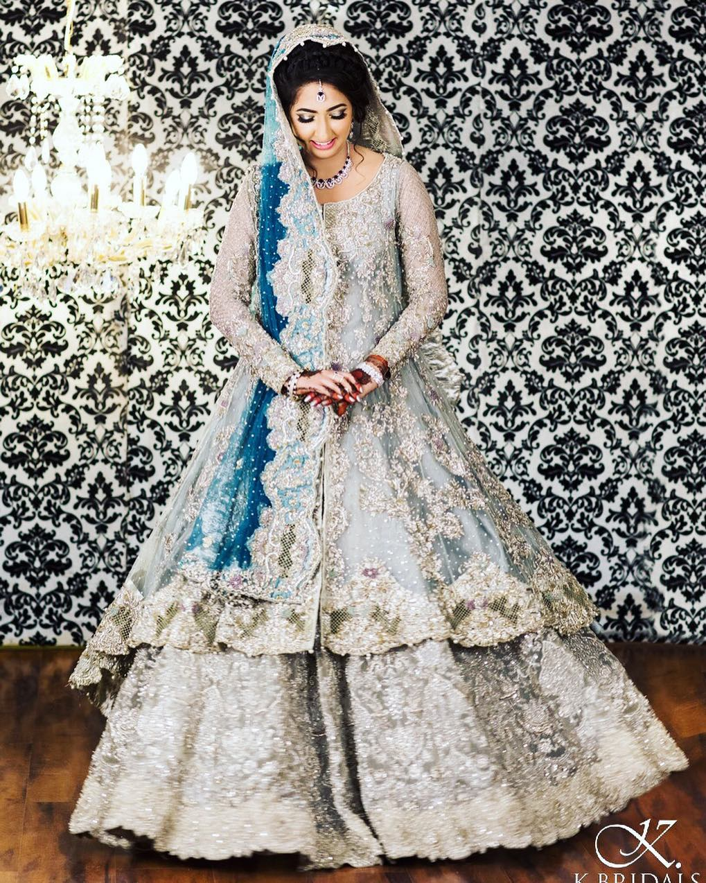 ed63e88460 ... wedding lehengas. Yet this bride makes us believe why it's the correct  choice. The front slit open long kurta with a skirt and the intricate  detailing ...