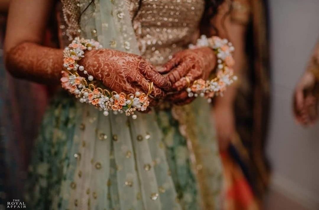 mehendi hands, henna hands, bride, indian bride, mehendi ceremony, pre wedding ceremony, floral jewellery, stunning hathphool, hathphool designs, hathphool, haathphool, sangeet ceremony, artificial flowers, orange flowers