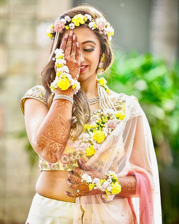 wedding, indian wedding, floral jewellery, yellow flowers, bride, indian bride, bridal makeup, mehendi ceremony, henna hands, mehendi hands, bride hands, pastels, happy faces