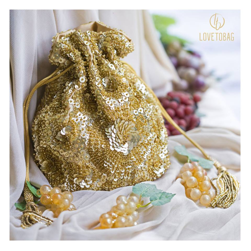 bridal potli, jivaana, golden potli bag