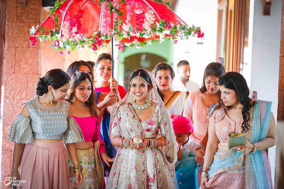 bridal entry, bride entry ideas, bride entry under umbrella