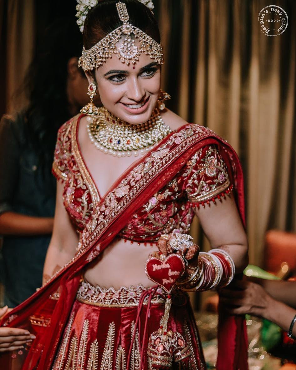 unique wedding trends, red bridal lehenga, bridal lehenga tassel design ideas, unique tassel design ideas