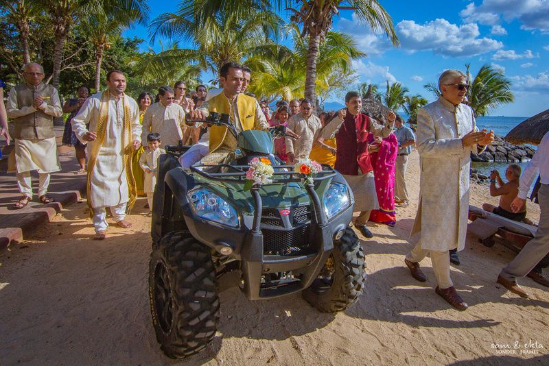 groom trends, groom entry, unique groom entry ideas, groom entering on a sand scooter