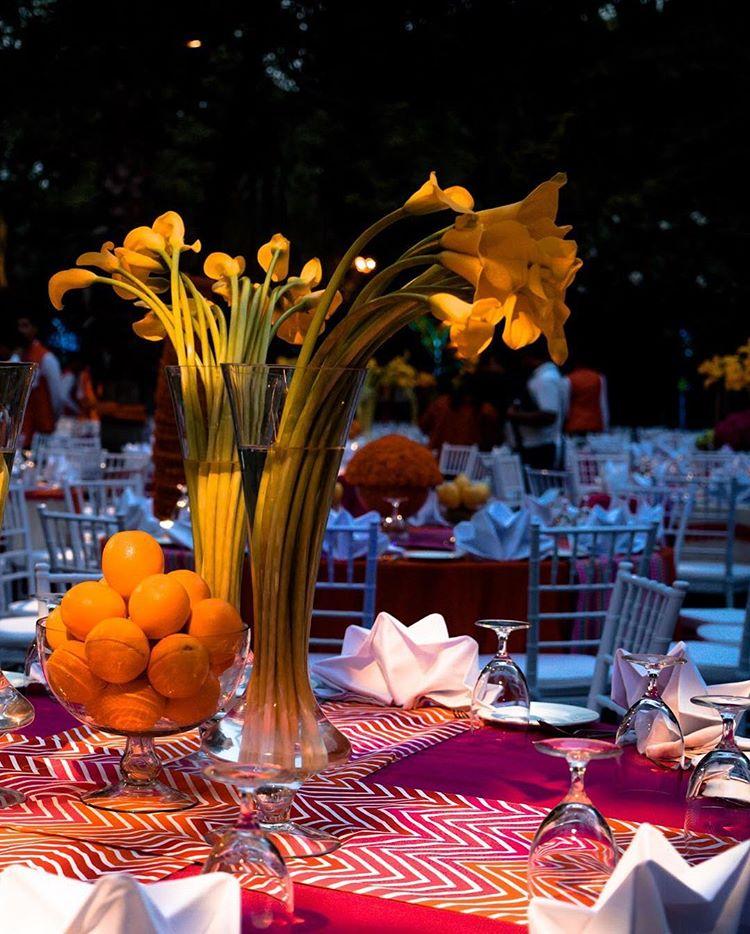 mehendi decor ideas, mehendi decor, mehendi decoration, orange and yellow theme decor