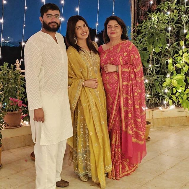 Priyanka Chopra, Kajol, mustard embroidered suit, wedding trousseau, wedding outfits ideas, Dia Mirza, pink embroidered suit, floor length suit, pakistani suit ideas