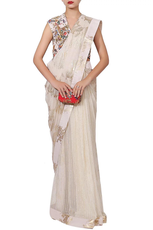 ivory colour outfit, wedding outfit ideas, wedding outfit inspiration, bridesmaid outfit ideas, printed saree, designer saree