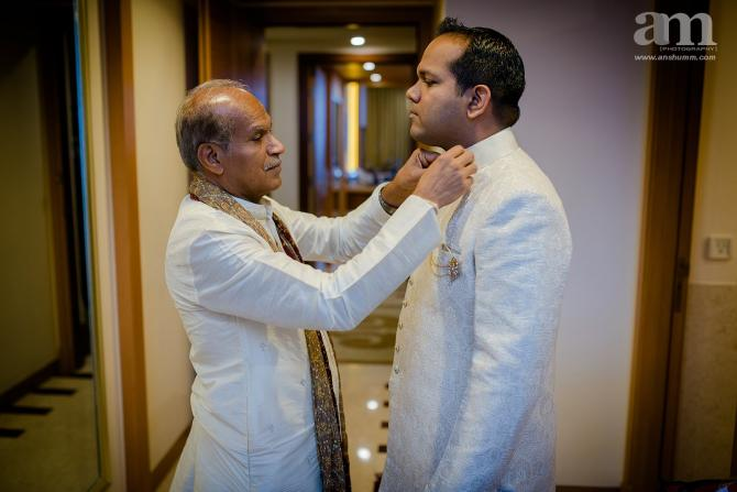 groom getting ready shot with father