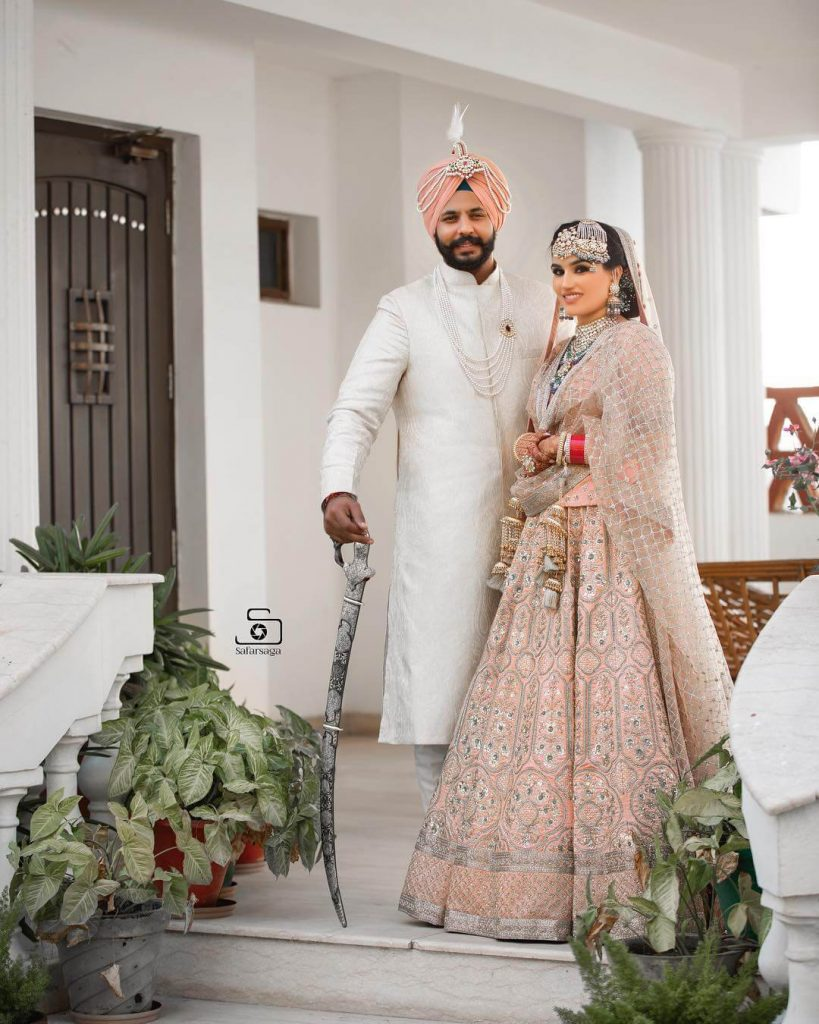 sikh couple portrait,Colour coordinated outfits