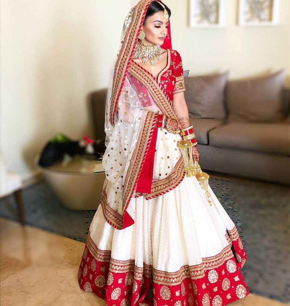 red and white bridal lehenga