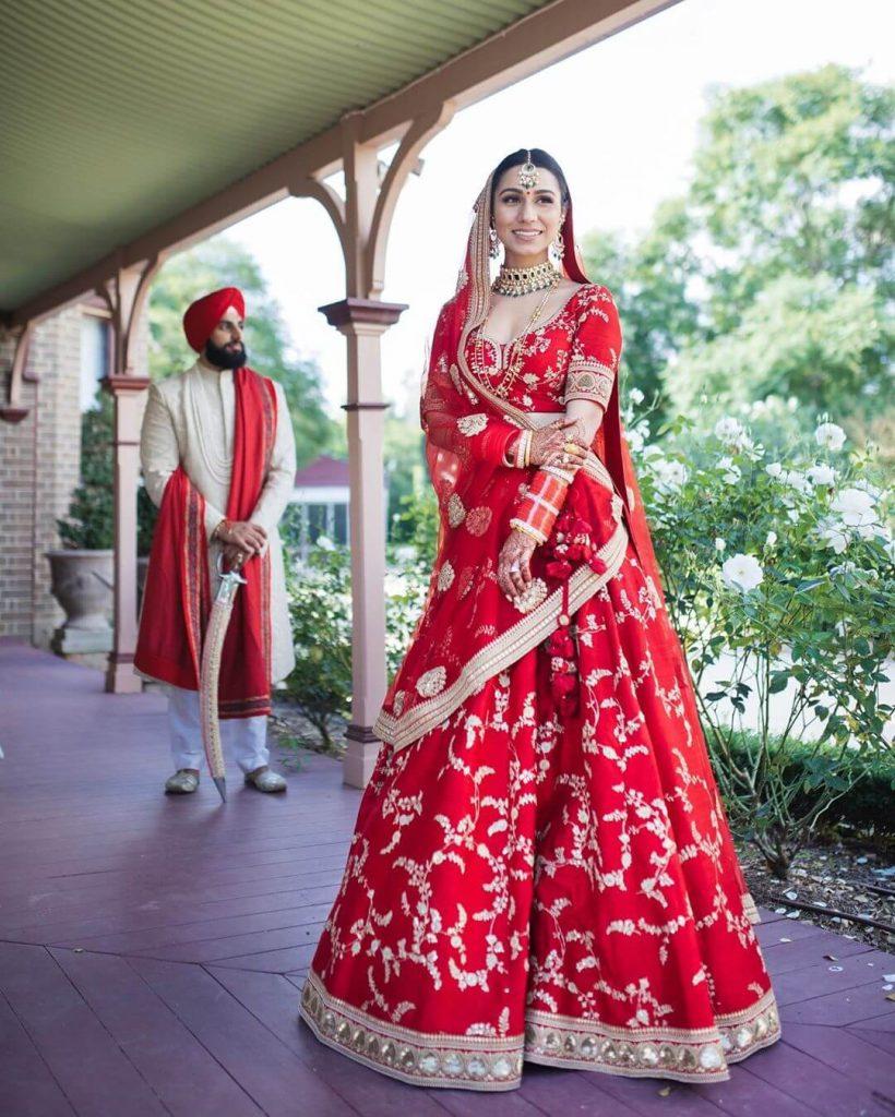 red bridal lehengas