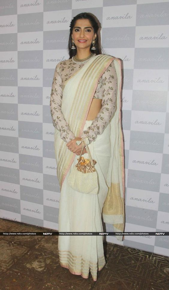 white and gold saree