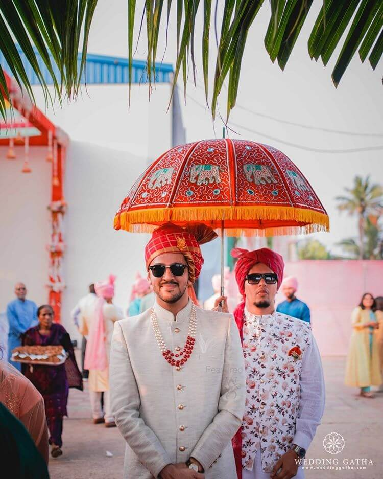 groom entry with umbrella