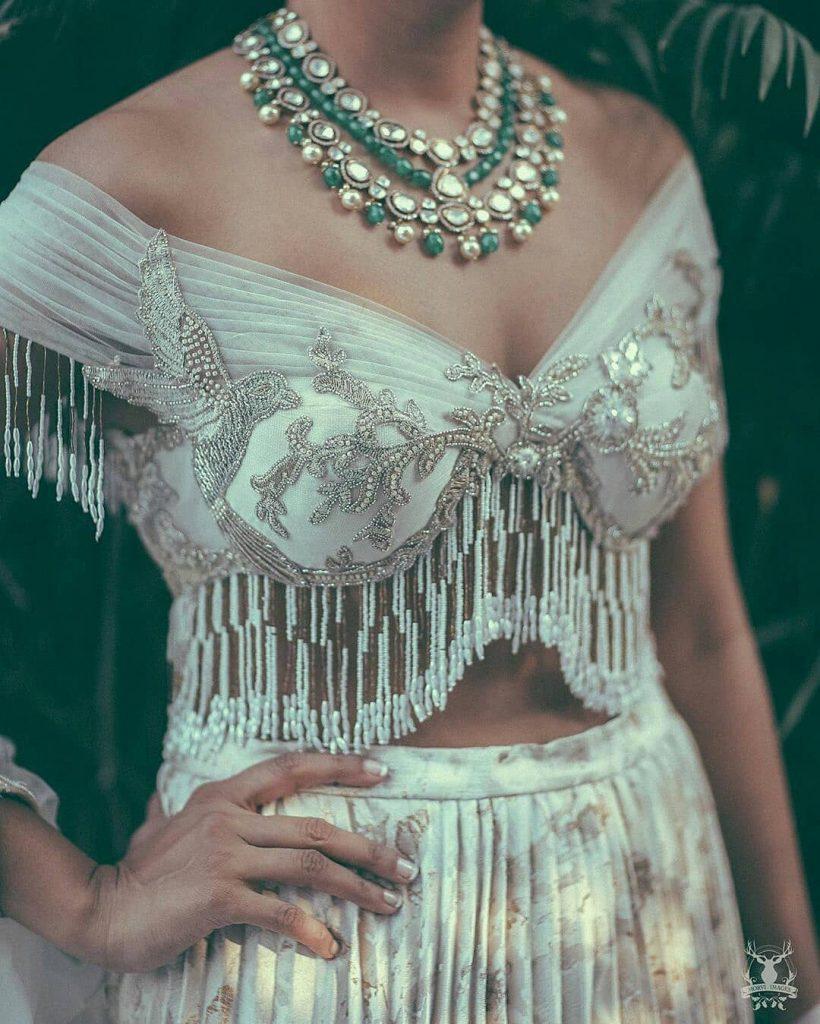 off-shoulder blouse design with fringes