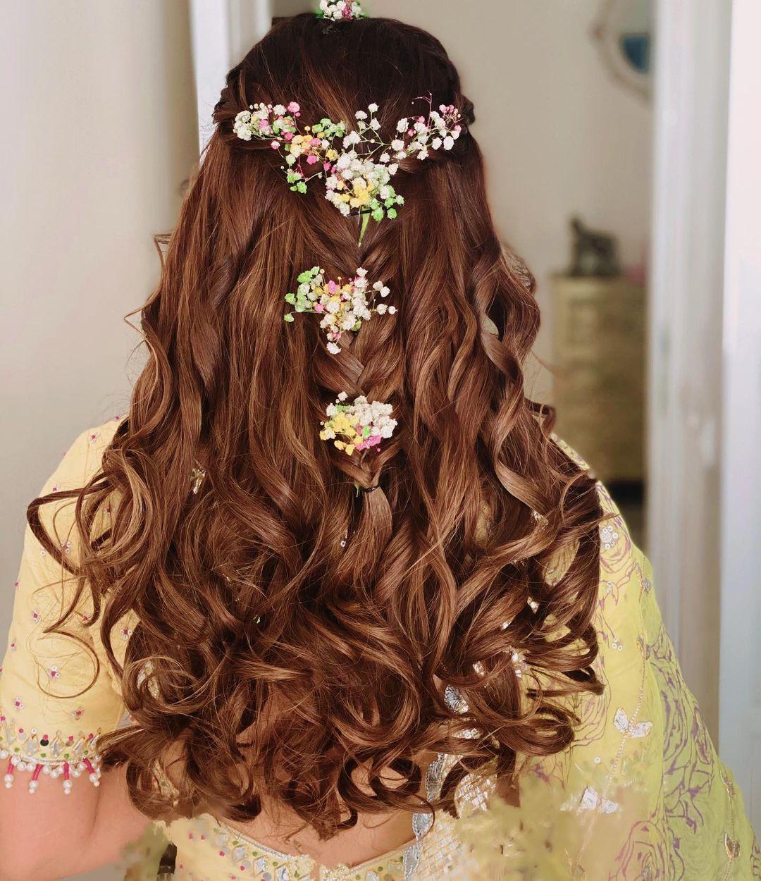 Gauahar Khan floral hairdo