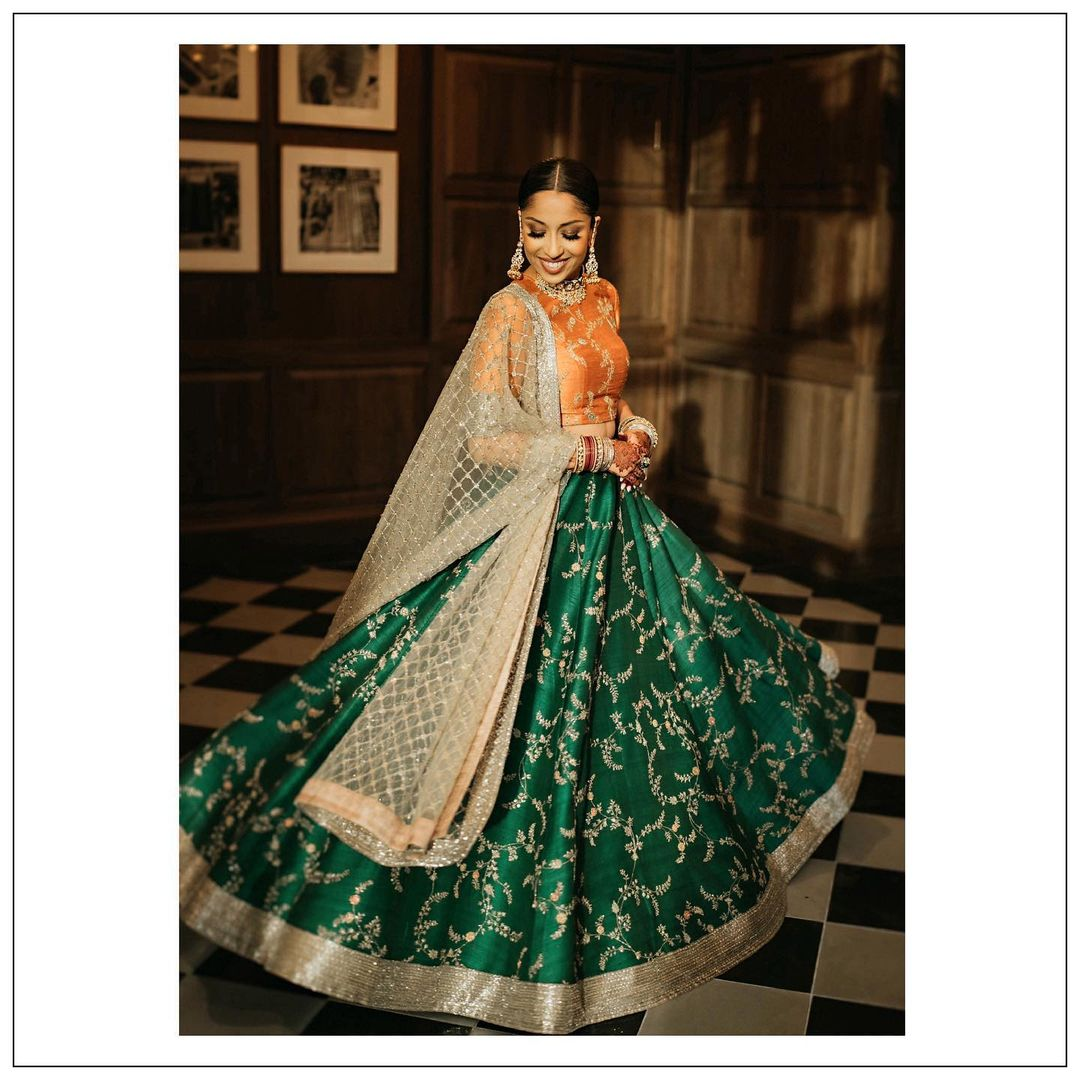 deep green lehenga with orange blouse