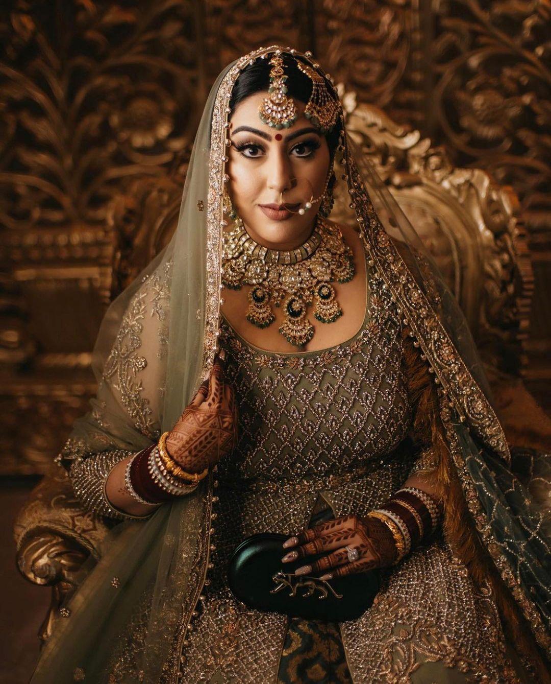 bride with sabyasachi clutch