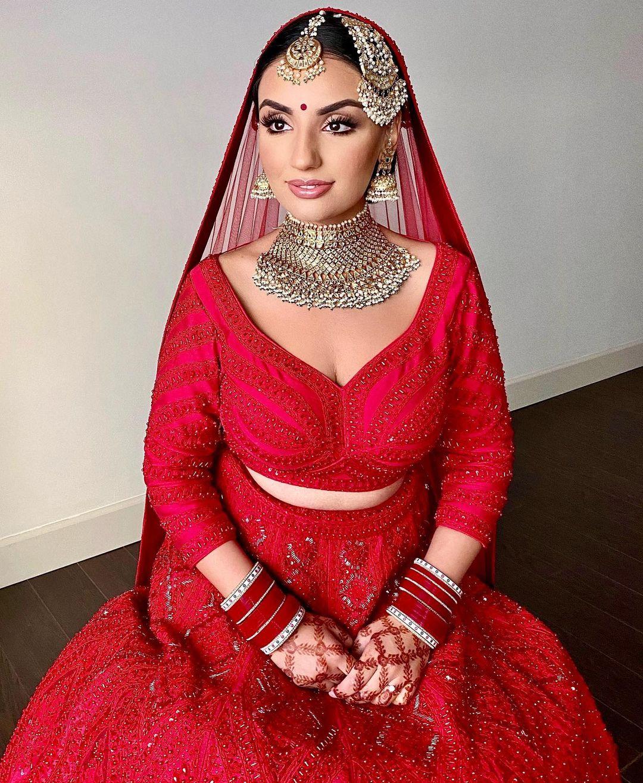 nude lip shade with red bridal lehenga