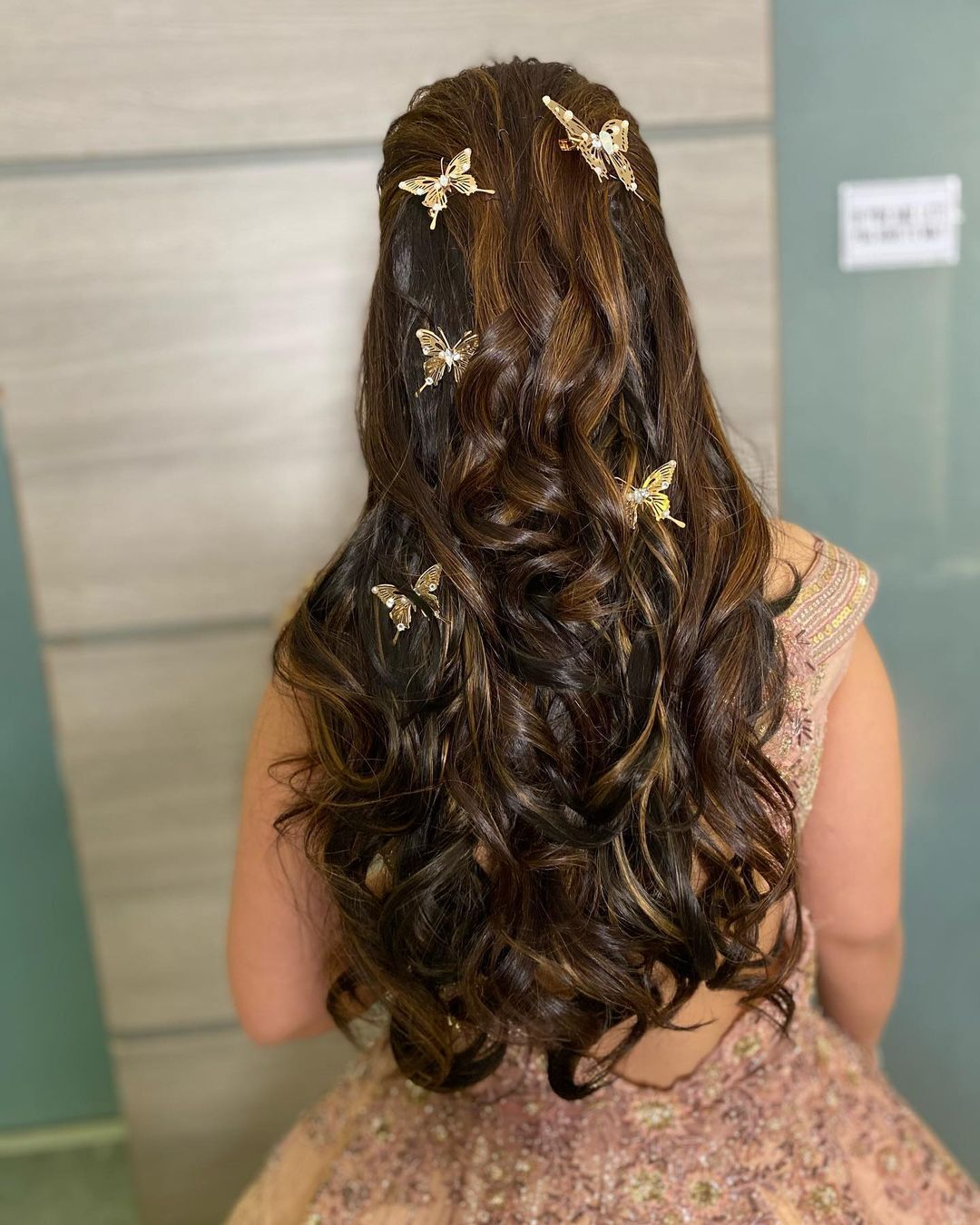 open hairstyle with butterfly accessories