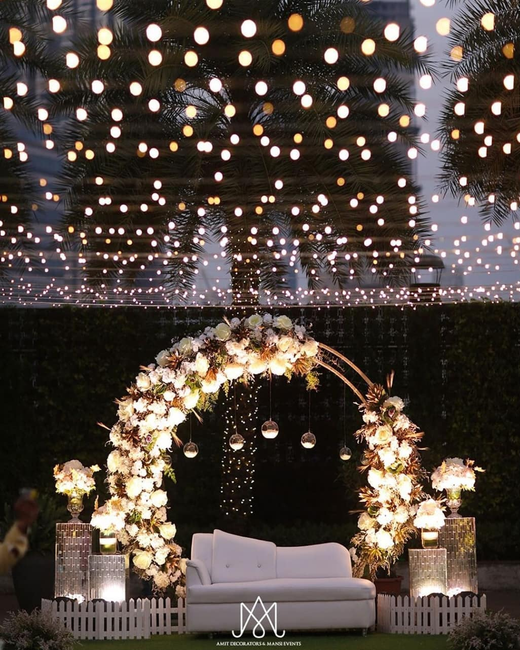 seating decor with flowers and lights