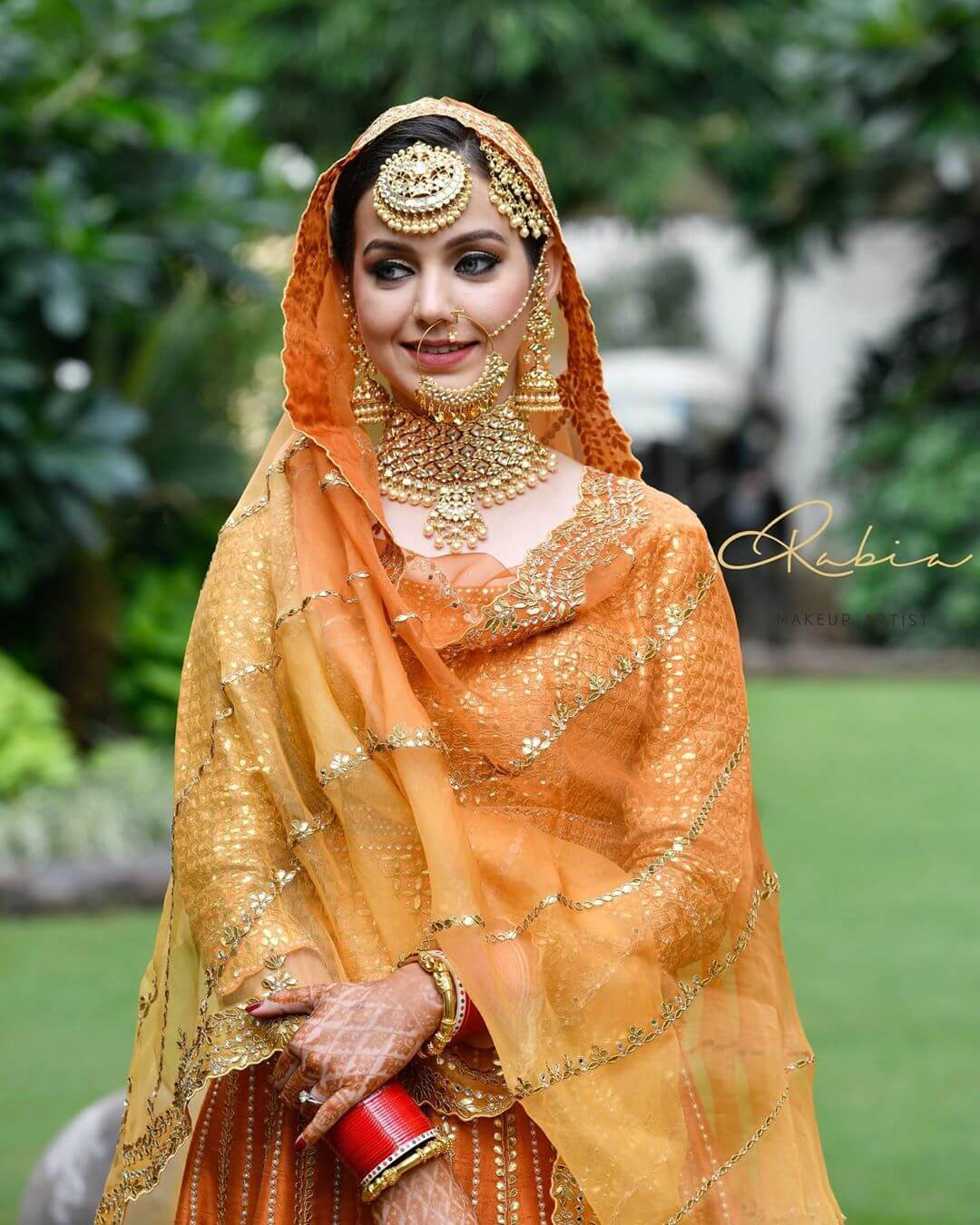 sikh bride in orange lehenga