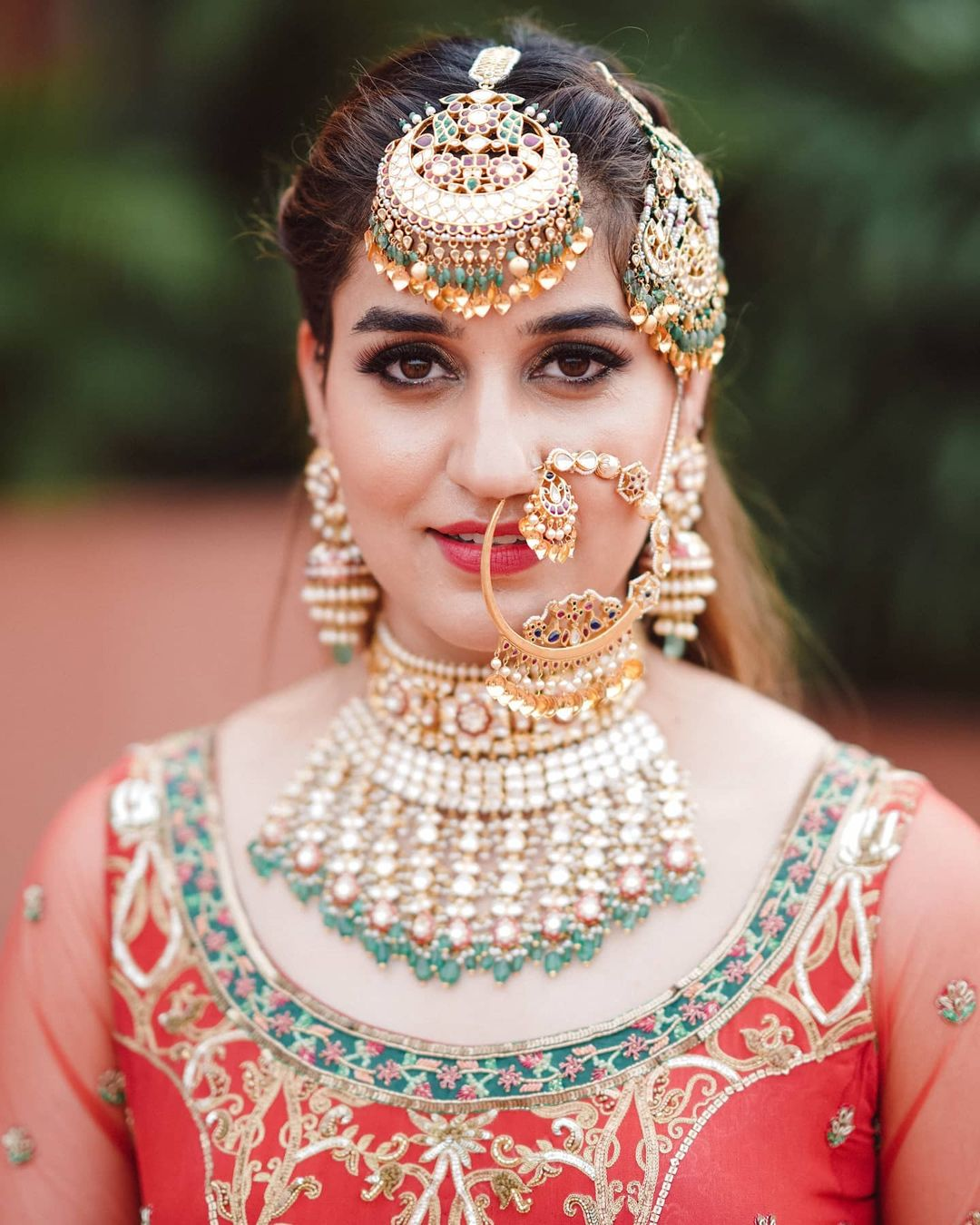 stunning maang tikka and bridal nath