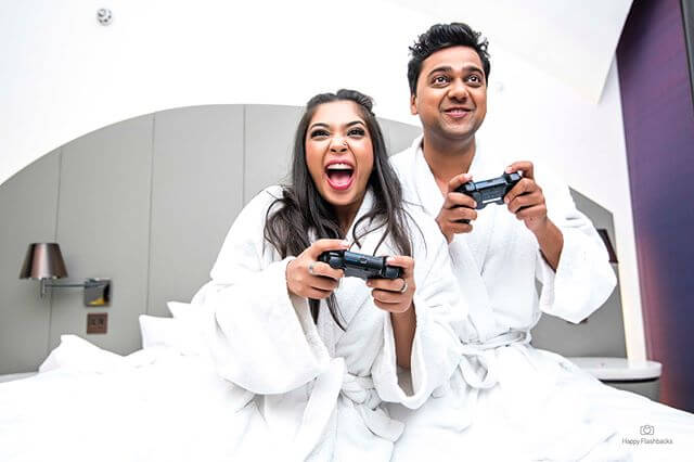 video games poses for pre-wedding shoot