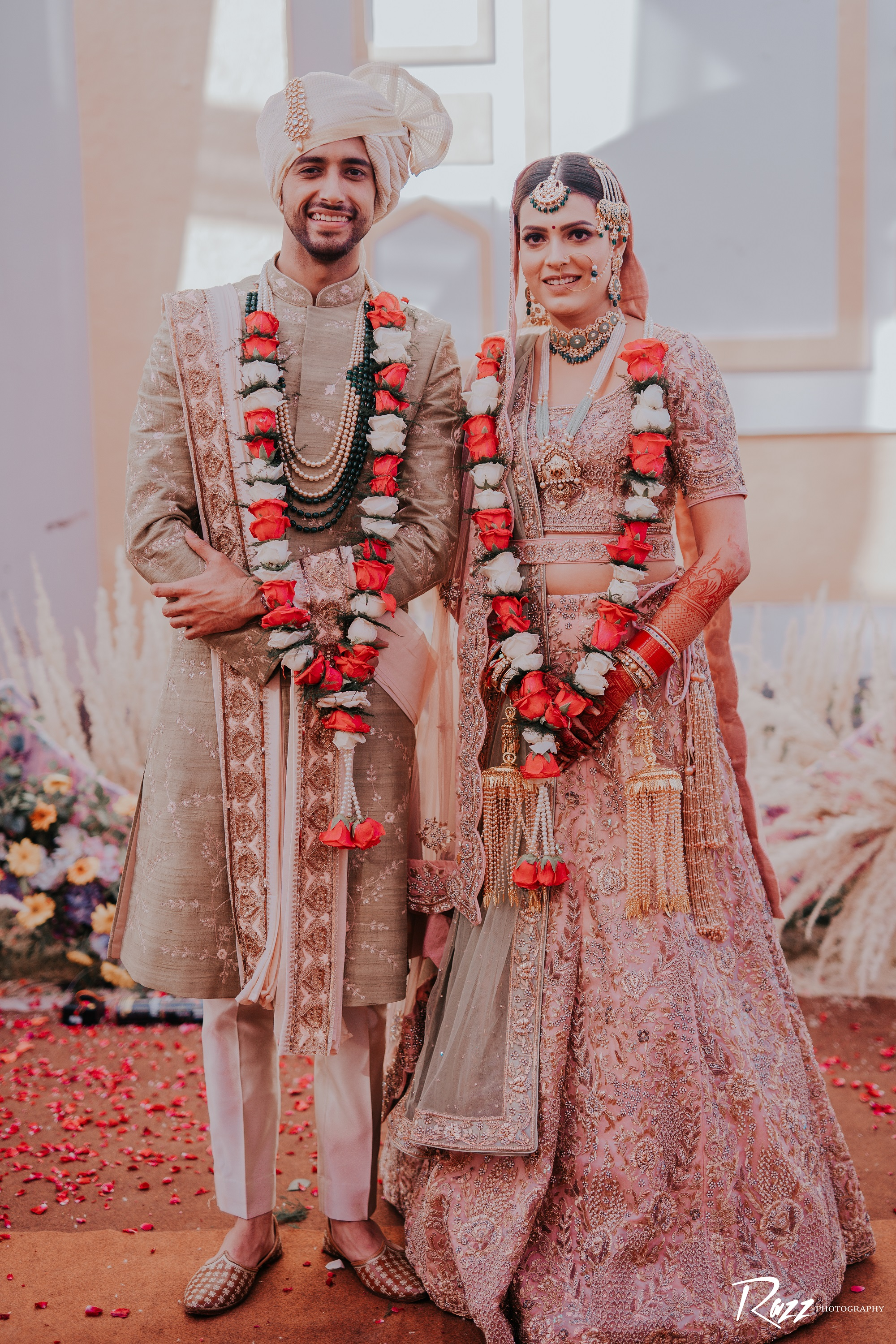 bride and groom in pastel outfits