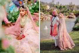 bride in baby pink lehenga