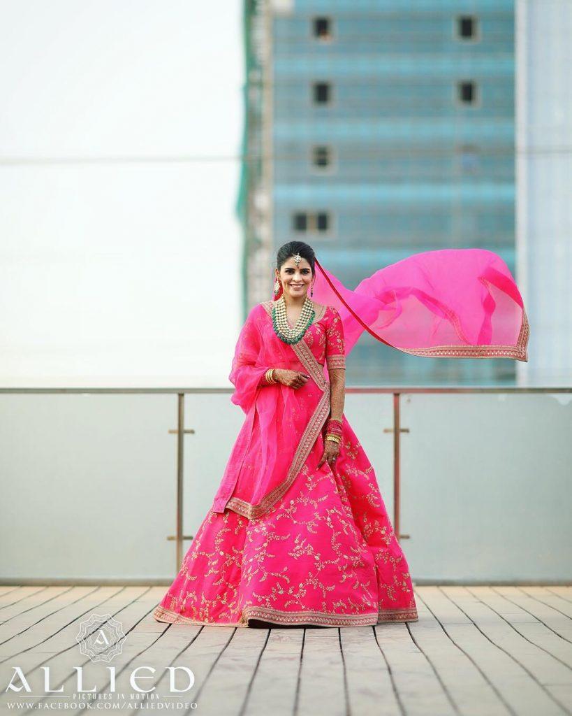 bride in pink sabyasachi lehenga