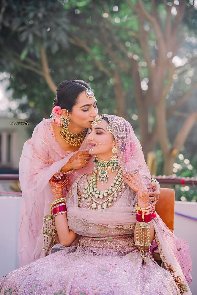 mother kissing bride shot