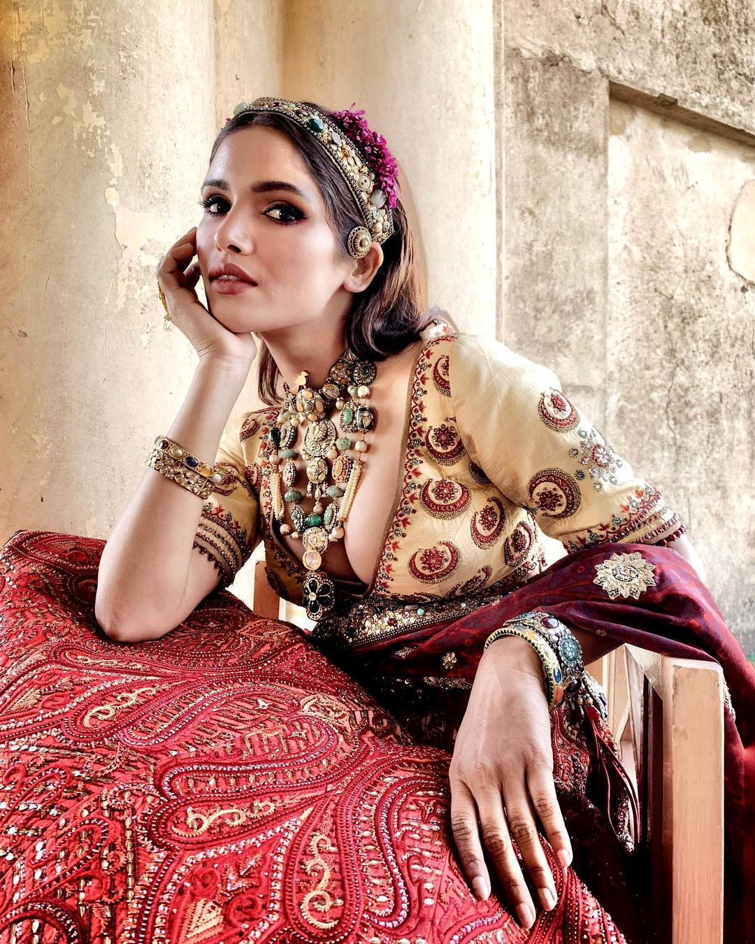 pale yellow blouse with red lehenga