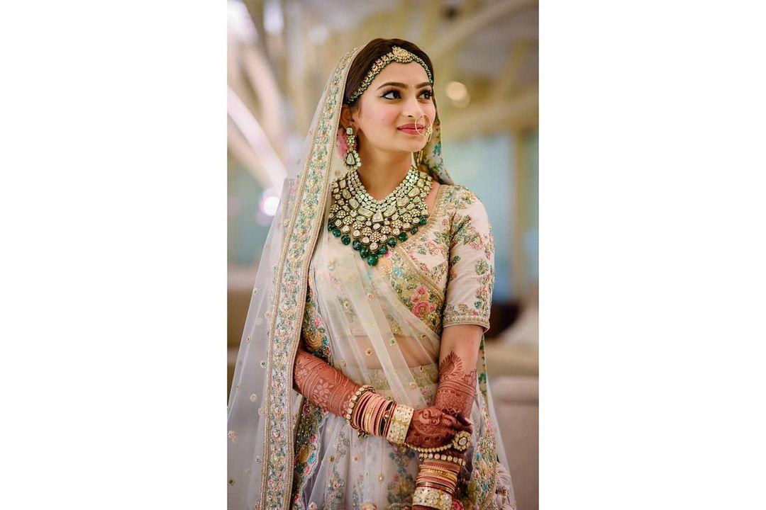 pink bridal lehenga with polki jewelry