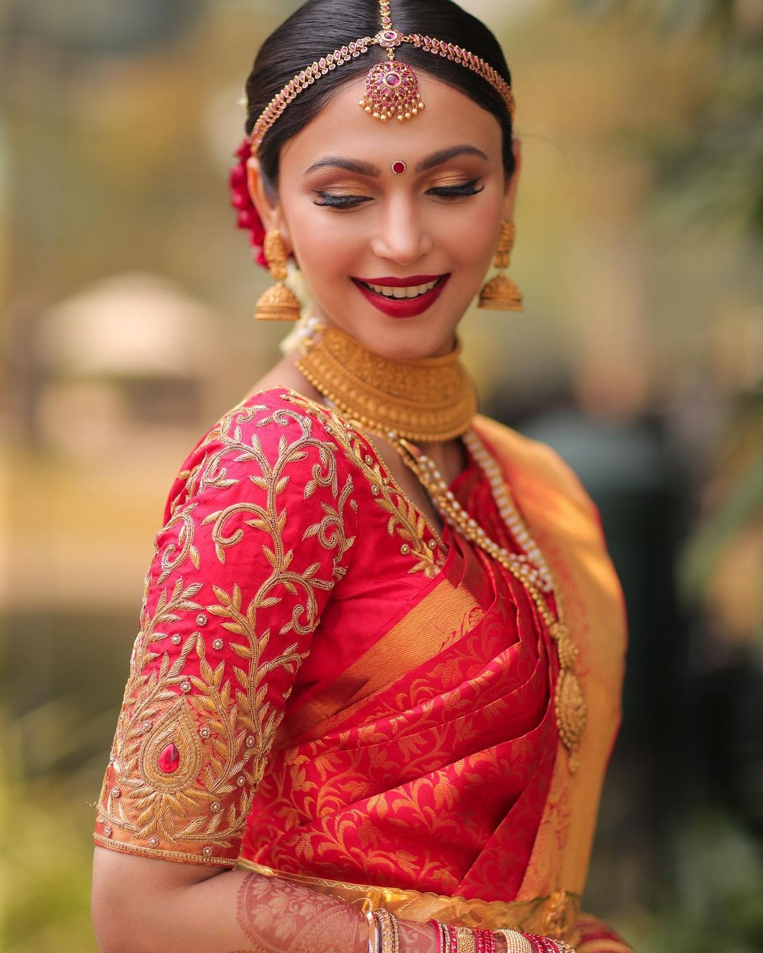 south Indian bride in red silk saree