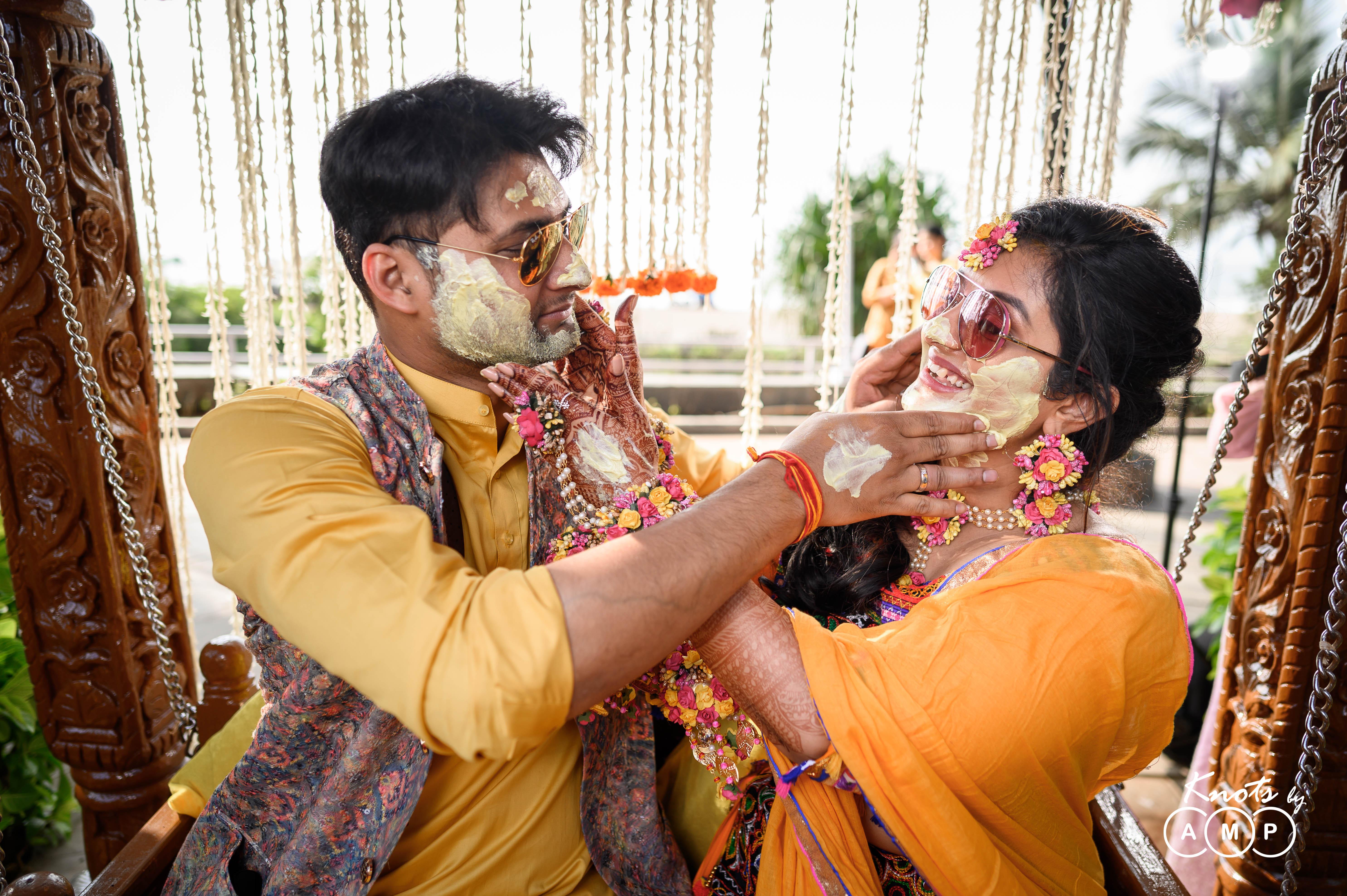 bride inorange lehenga with pom poms