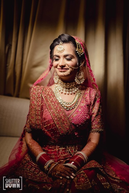 bride in pink lehenga