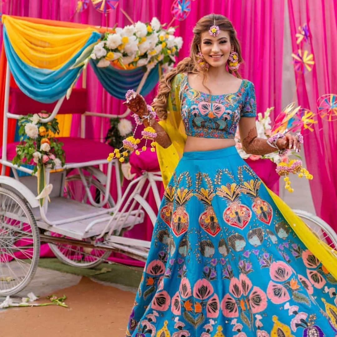 blue lehenga with colorful details