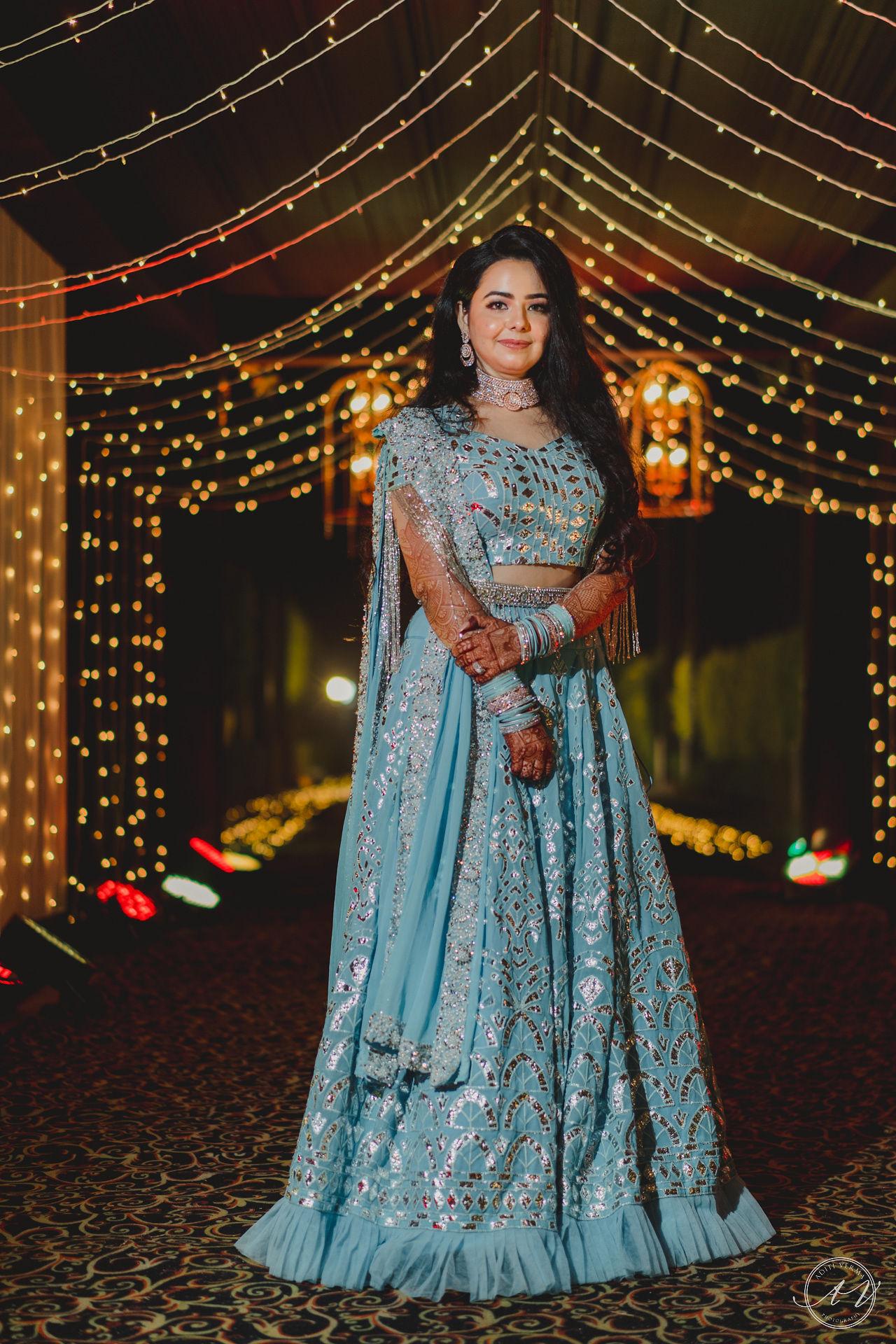 bride in baby blue lehenga