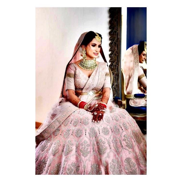 pink bridal lehenga with belt
