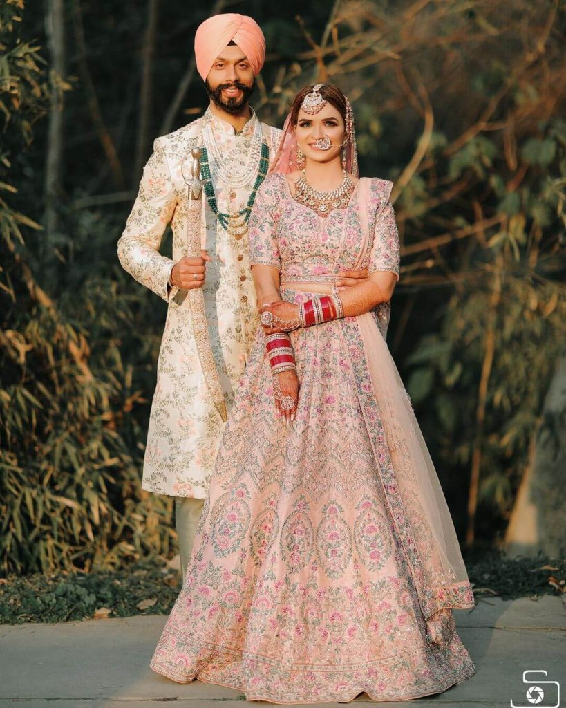 Sikh couple dressed in pastels