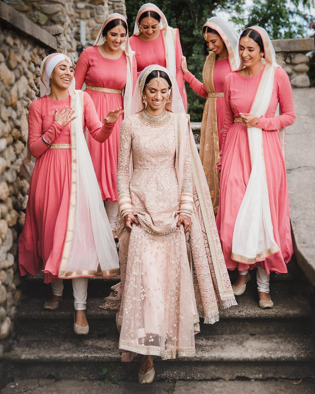 bride and bridesmaid wearing pink