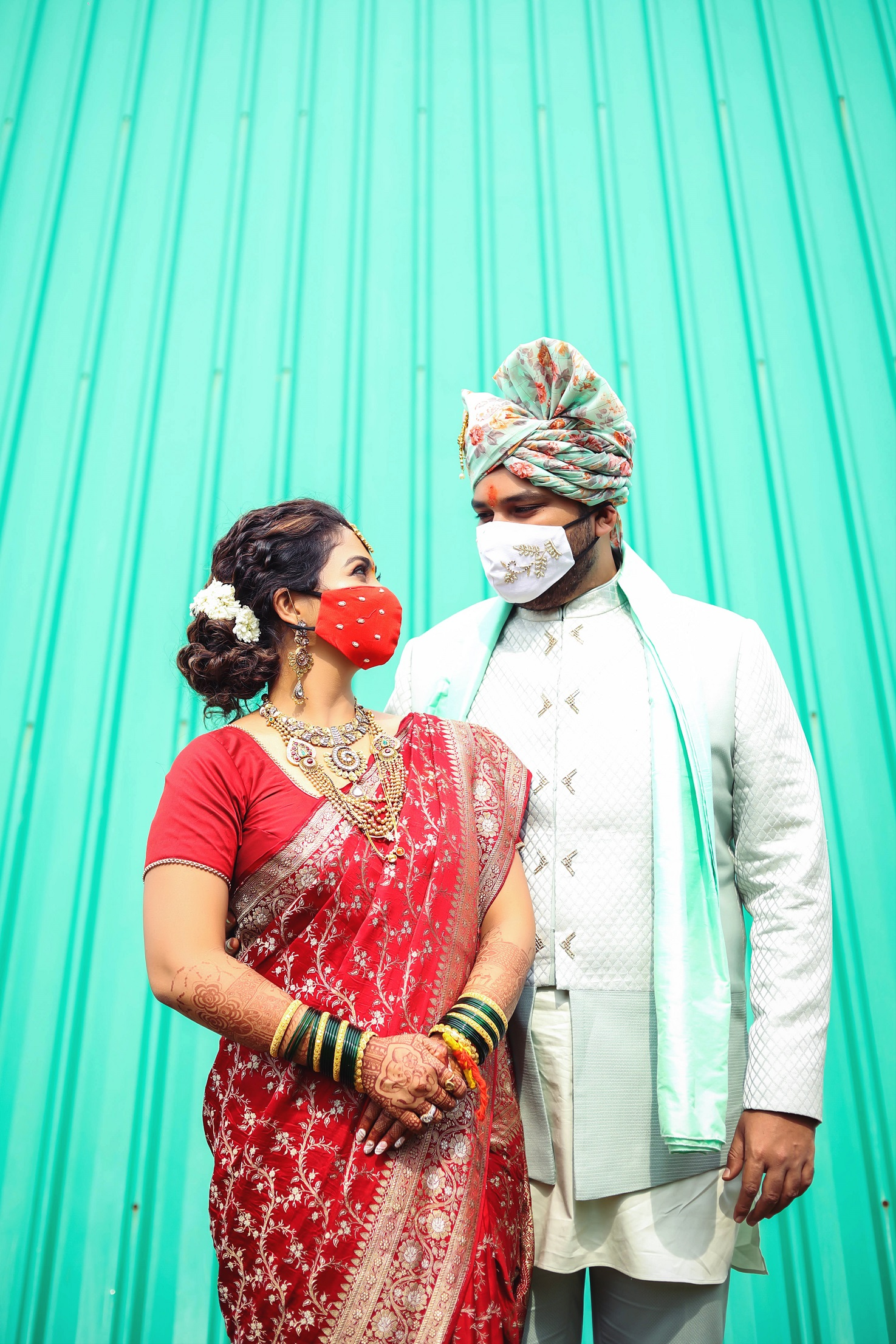 bride and groom with masks