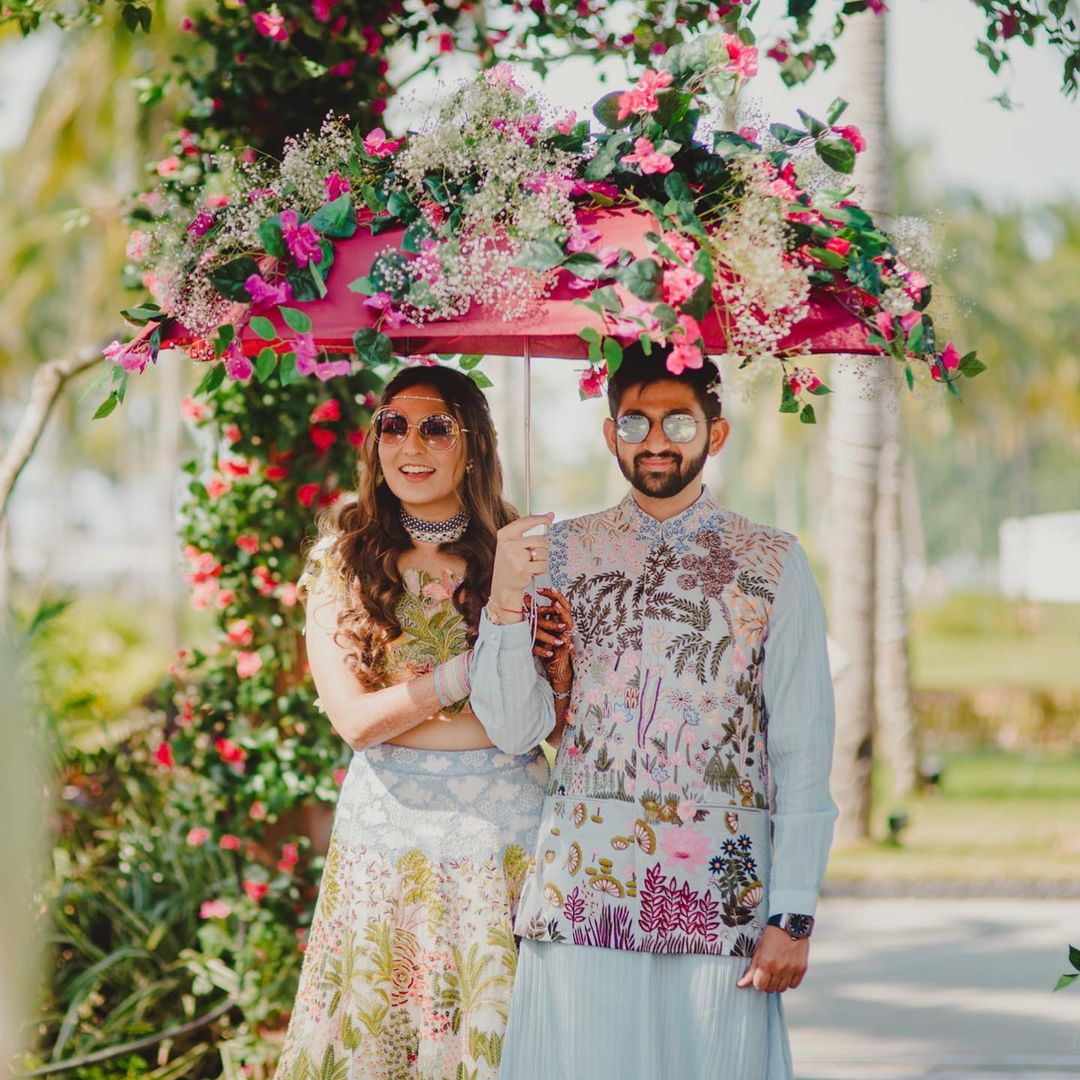 couple wearing floral print outfits