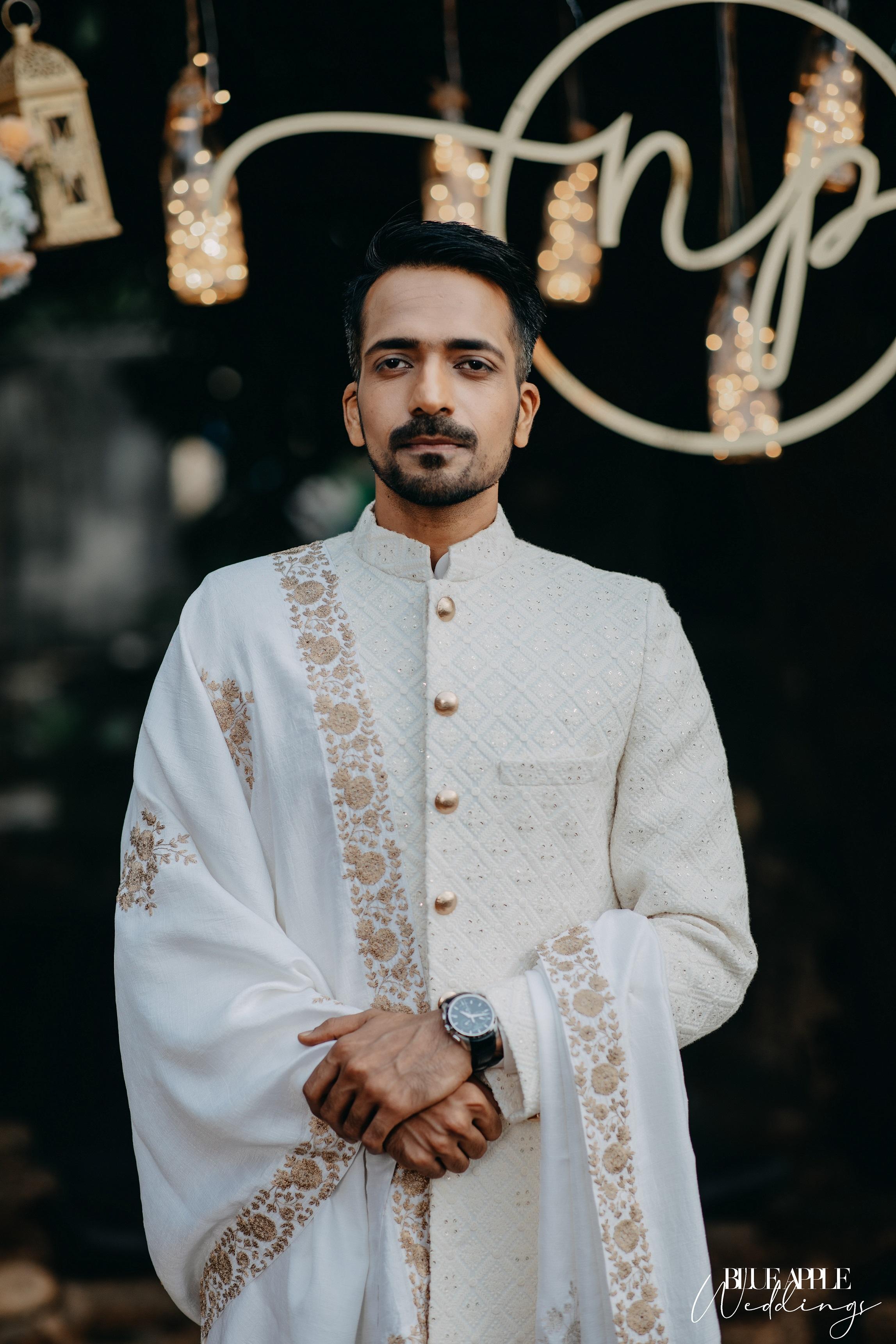 groom white sherwani